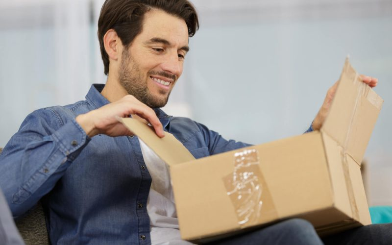 Man opening delivery box